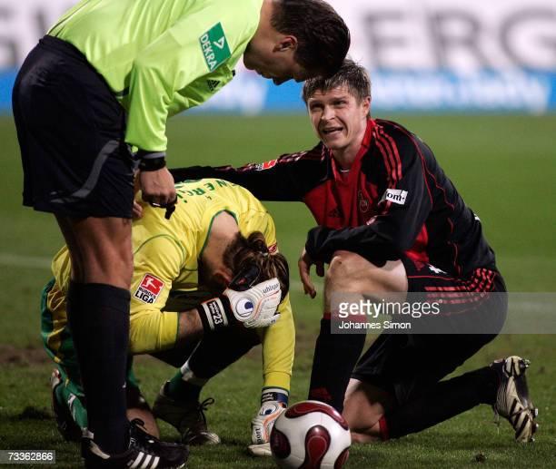 Vratislav Gresko of Nuremberg and referee Thorsten Kinhoefer speak to hurt Cottbus goalkeeper Tomislav Piplica during the Bundesliga match between...
