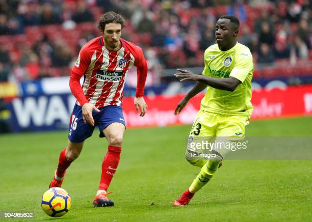 Vrsaljko of Atletico Madrid and Amath of Getafe battle for the ball during the La Liga match between Atletico Madrid and Getafe at Estadio Wanda...