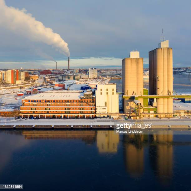 värtahamnen in stockholm - district heating plant stock pictures, royalty-free photos & images
