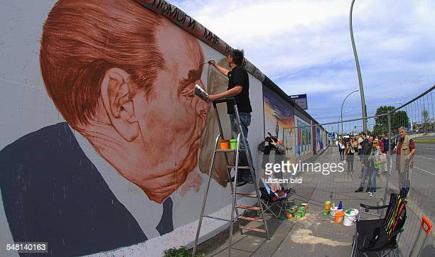 Vrubel Dimitry Painter Artist Russia During the restauration of the painting 'Brotherly Kiss at the East Side Gallery in Friedrichshain
