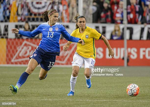 USA vs Brazil Women's Soccer USA forward Alex Morgan and Brazil midfielder Marta during an International Friendly at CenturyLink Field in Seattle...