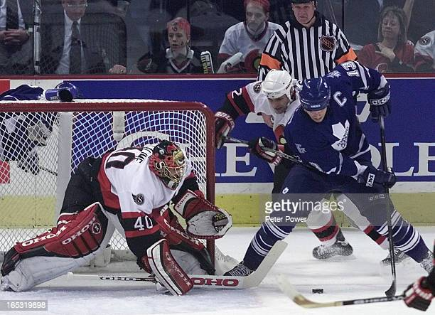 LEAFS vs OTTAWAGAME 2Last night's hero Leaf captain Mats Sundin tries a wraparound on Patrick Lalime while Curtis Leschyshyn tries to hold him up...
