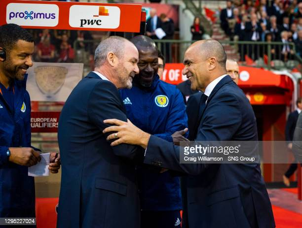 Vs SCOTLAND.KING BAUDOUIN STADIUM - BRUSSELS .Scotland Manager Steve Clarke and Roberto Martinez shake hands pre-match
