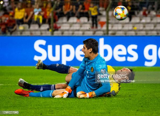 Vs SCOTLAND.KING BAUDOUIN STADIUM - BRUSSELS .Scotland's Scott McKenna has a chance to pull one back but is denied by Thibaut Courtois.