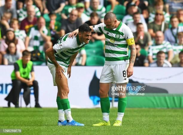 Vs ST JOHSNTONE.CELTIC PARK - GLASGOW.Celtic's Hatem Abd Elhamed holds his thigh as Scott Brown watches on.