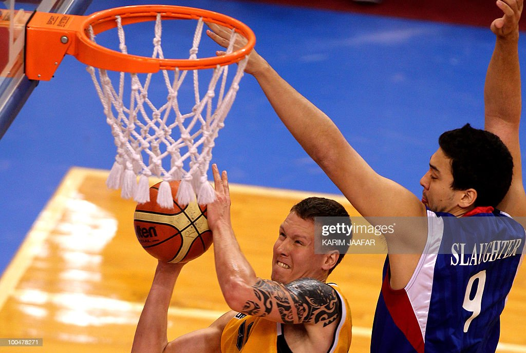 Vsevolod Fadeikin (L) of Kazakhstan's Astana Tigers club jumps for the basket as Gregory William Slaughter (R) of Philippines Smart Gilas club tries to stop him during their 21st FIBA Asia Champions Cup basketball match at the Al-Gharafa indoors stadium in Doha on May 24, 2010.