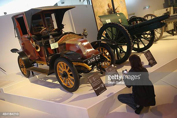 A vsitor looks at a Renault taxi like those used to transport 6000 French soldiers from Paris to the front in the First Battle of the Marne during...