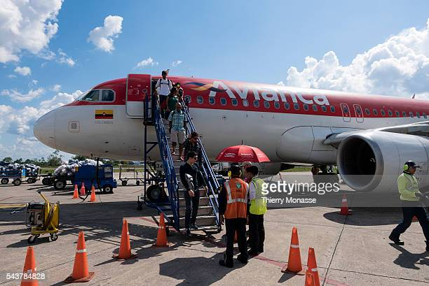 Vásquez Cobo International Airport Leticia Republic of Colombia August 5 2015 Passengers are going down an Airbus A319 from Avianca Avianca SA is the...