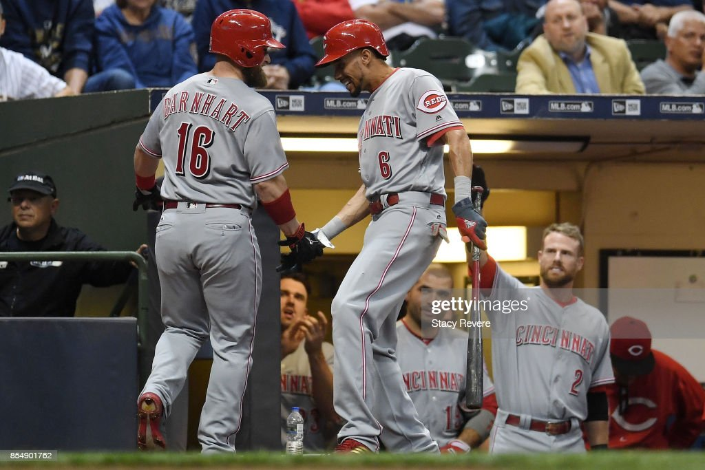 vTucker Barnhart #16 of the Cincinnati Reds is congratulated by Billy Hamilton #6 after a solo atome run against the Milwaukee Brewers during the third inning of a game Miller Park on September 27, 2017 in Milwaukee, Wisconsin.