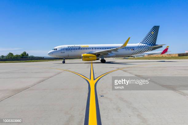 vueling airlines aircraft at the boryspil international airport, ukraine - taxiing stock pictures, royalty-free photos & images