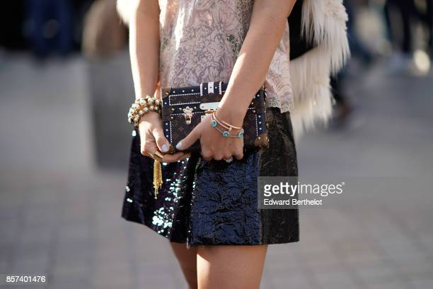 Vuitton clutch outside Louis Vuitton during Paris Fashion Week Womenswear Spring/Summer 2018 on October 3 2017 in Paris France