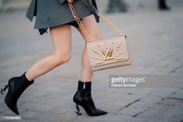 Vuitton LV bag is seen outside Louis Vuitton during Paris Fashion Week Womenswear Fall/Winter 2019/2020 on March 05 2019 in Paris France