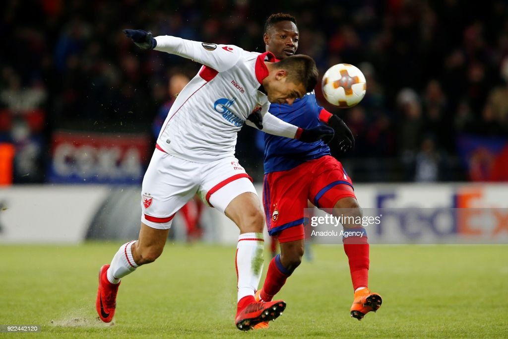 Vujadin Savic (L) of Crvena Zvezda in action against Ahmed Musa (R) of CSKA Moscow during the UEFA Europa League round of 32, second leg soccer match between CSKA Moscow and Crvena Zvezda at the Stadium CSKA Moscow in Moscow, Russia on February 21, 2018.