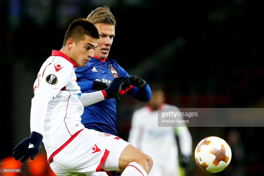 Vujadin Savic (L) of Crvena Zvezda in action against Pontus Wernbloom (R) of CSKA Moscow during the UEFA Europa League round of 32, second leg soccer match between CSKA Moscow and Crvena Zvezda at the Stadium CSKA Moscow in Moscow, Russia on February 21, 2018.