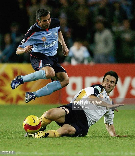 Vuko Tomasevic of the Mariners tackles Steve Corica of Sydney FC during the round one A-League match between Sydney FC and the Central Coast Mariners...
