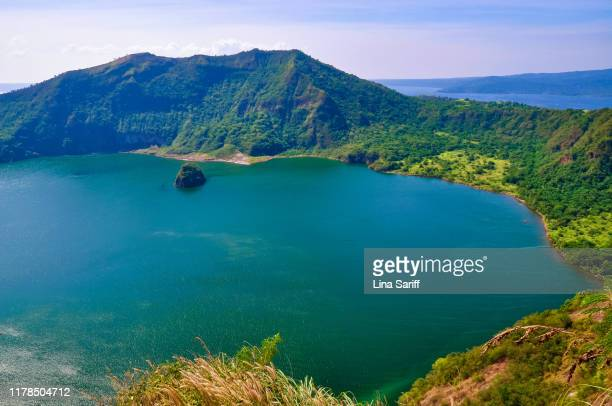 vulcan point island in crater lake, taal volcano in tagaytay, philippines. - taal volcano stock photos and pictures