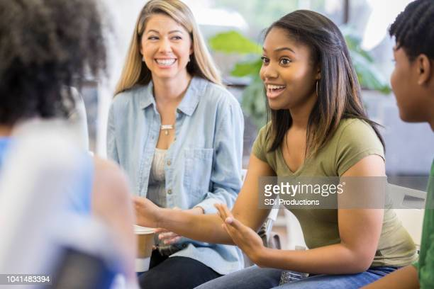 vulnerable teen talks during group therapy session - storytelling stock pictures, royalty-free photos & images