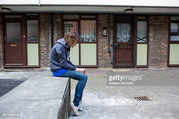 Vulnerable teenage youth hanging about on a Hackney estate, London. UK