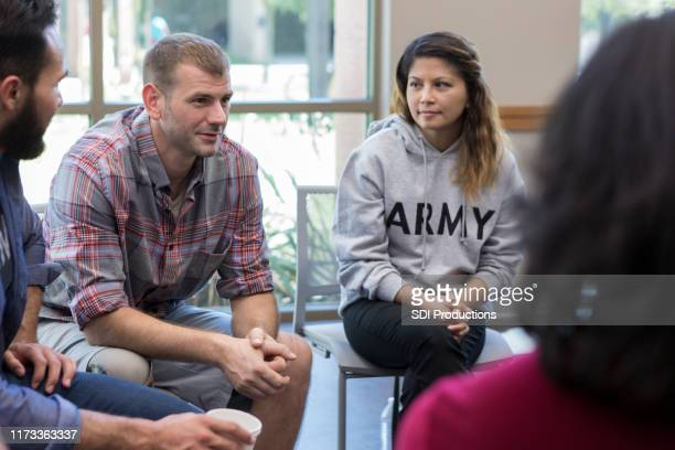 vulnerable veterans talks during therapy session - vulnerability stock pictures, royalty-free photos & images