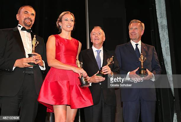 Vural Oeger Christine Theiss Richard Blackford Christian Wulff with award during the 'Die Goldene Deutschland' Gala on July 26 2015 at Cuvillies...