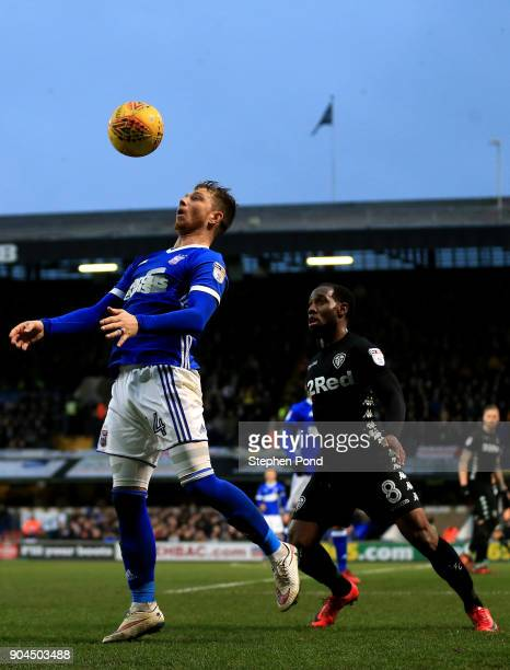 Vurnon Anita of Leeds United and Joe Garner of Ipswich Town compete for the ball during the Sky Bet Championship match between Ipswich Town and Leeds...