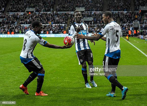 Vurnon Anita of Newcastle hands Georginio Wijnaldum of Newcastle the match ball after scoring his fourth and Newcastle's sixth goal during the...