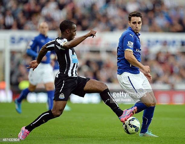 Vurnon Anita of Newcastle United and Matthew James of Leicester City compete for the ball during the Barclays Premier League match between Newcastle...