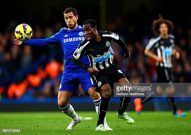 Vurnon Anita of Newcastle United battles for the ball with Eden Hazard of Chelsea during the Barclays Premier League match between Chelsea and...