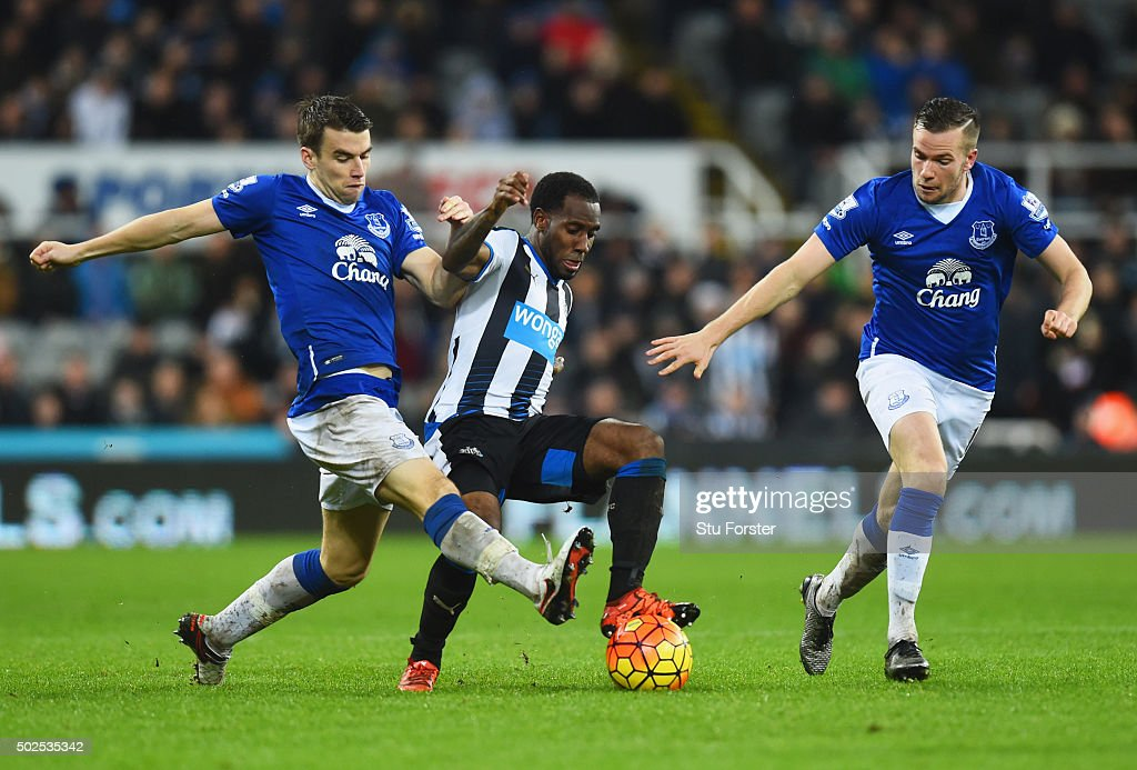 Vurnon Anita of Newcastle United battles with Seamus Coleman (L) and Tom Cleverley of Everton during the Barclays Premier League match between Newcastle United and Everton at St James' Park on December 26, 2015 in Newcastle upon Tyne, England.