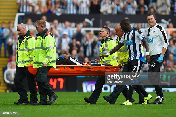 Vurnon Anita of Newcastle United is stretchered off during the Barclays Premier League match between Newcastle United and Southampton at St James'...