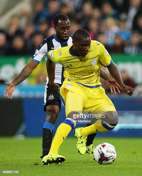 Vurnon Anita of Newcastle United vies with Jérémy Helan of Sheffield Wednesday during the Capital One Cup Third Round match between Newcastle...