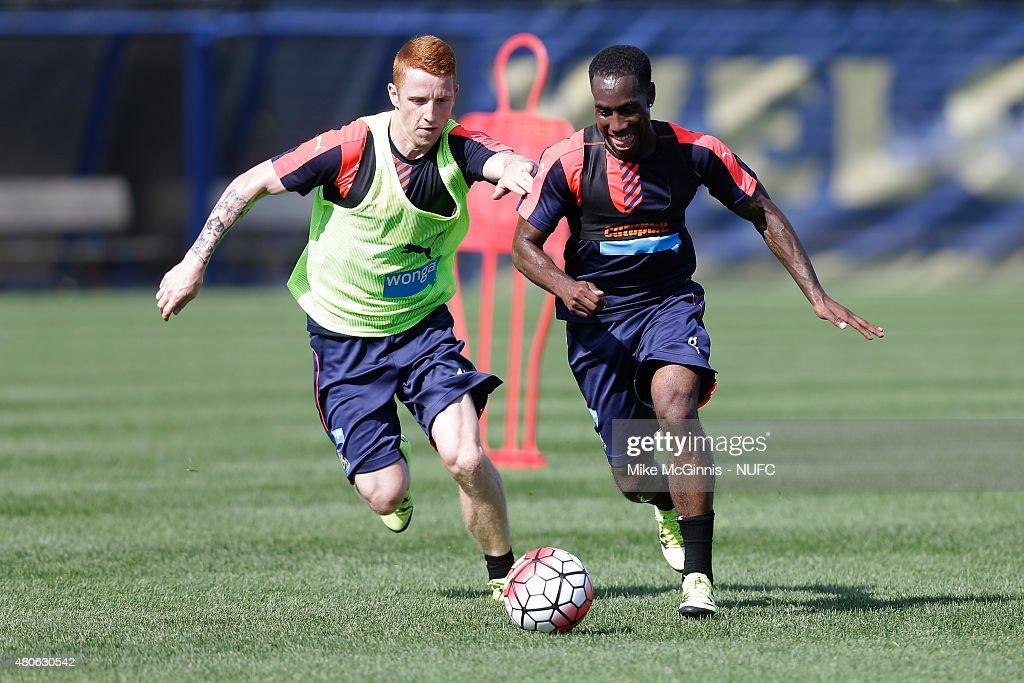 Vurnon Anita #8 of the New Castle United and (l)Jack Colback #14 run through some drills during practice at Marquette University Valley Fields on July 13, 2015, in Milwaukee, Wisconsin.
