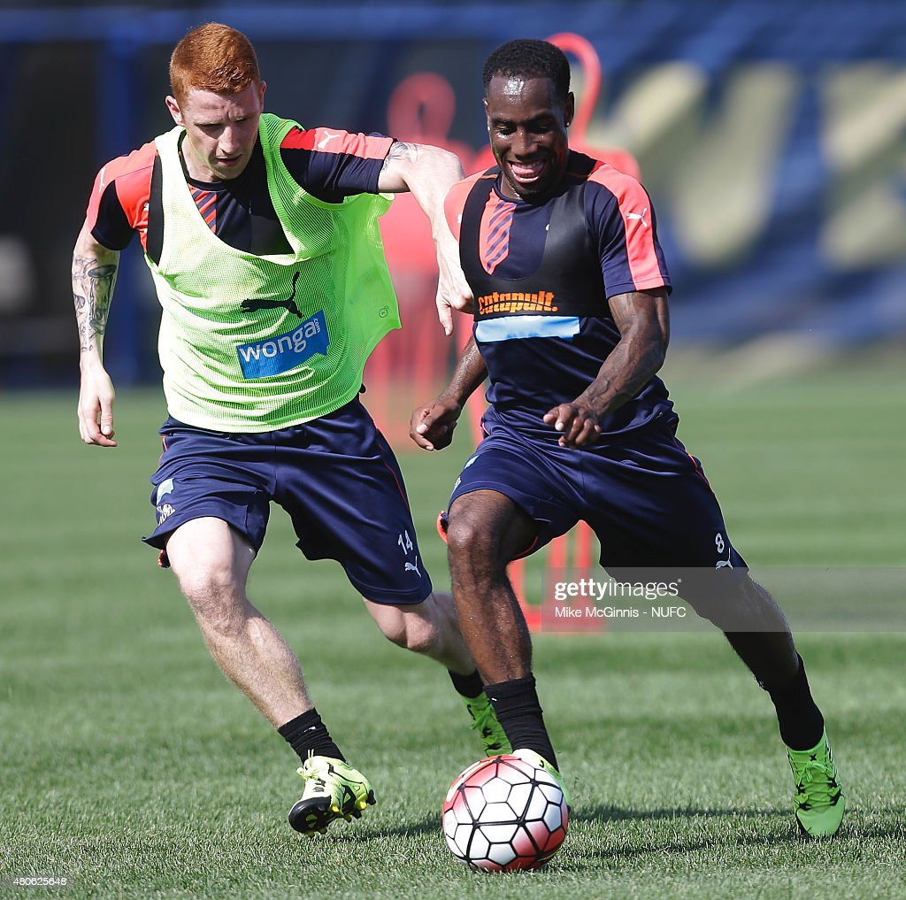 Vurnon Anita #8 of the Newcastle United and (l)Jack Colback #14 run through some drills during practice at Marquette University Valley Fields on July 13, 2015, in Milwaukee, Wisconsin.