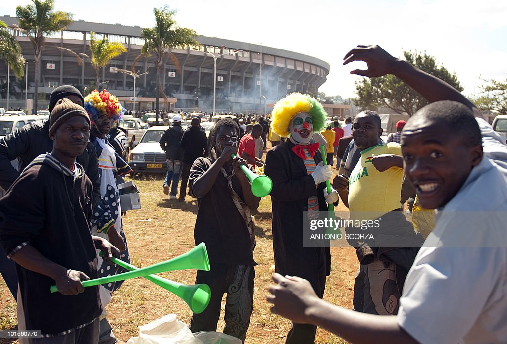 Vuvuzela salesmen play the horn on June 2, 2010 outside the National Sport Stadium in Harare as people arrive to watch a friendly football match opposing Brazil to Zimbabwe. The Brazilian national team is preparing for the 2010 FIFA World Cup in South Africa.