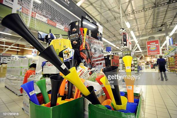 Vuvuzela trumpets for sale are seen amid Football World Cup 2010 goods on May 21 2010 in a supermarket at Maponya shopping mall in Soweto AFP PHOTO/...