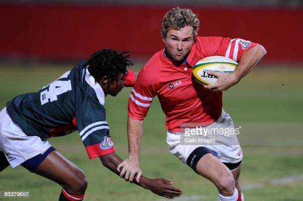 Vuyo Zangqa tackles Poerie van Rooyen during the Absa Currie Cup Promotion and Relegation match between Valke and Platinum Leopards held at Bosman...