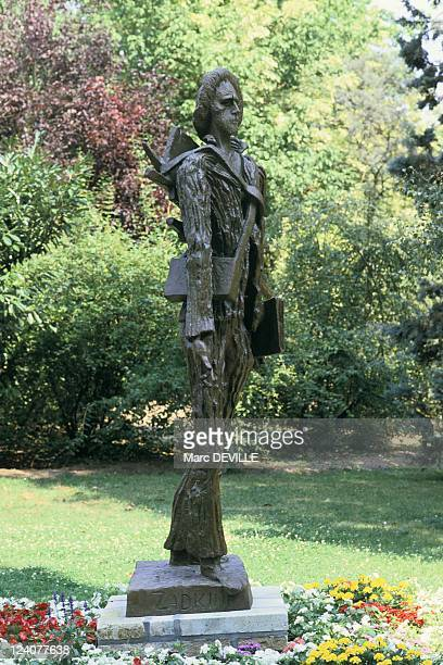 Museum in Amsterdam his tomb his house in Auvers Sur Oise France in November 1989 The statue of Vincent Van Gogh in AuverssurOise