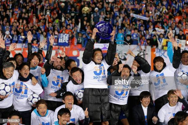Varen Nagasaki players and staffs celebrate after their 31 victory and the promotion to the J1 with supporters after the JLeague J2 match between...