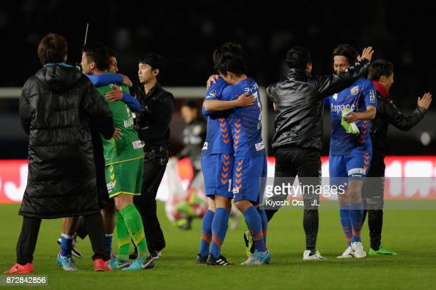 Varen Nagasaki players celebrate after their team's promotion to the J1 after their 31 victory in the JLeague J2 match between VVaren Nagasaki and...