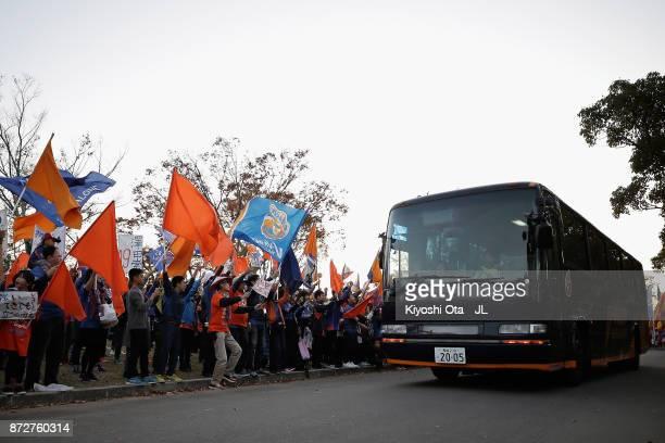 Varen Nagasaki supporters cheer as a team bus carrying VVaren Nagasaki players arrives at the stadium prior to the JLeague J2 match between VVaren...