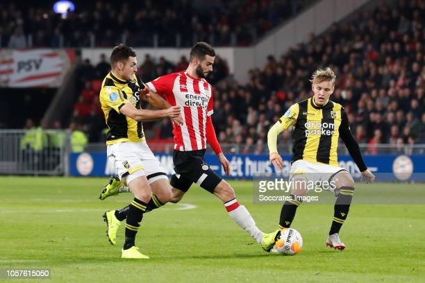 Vyacheslav Karavaev of Vitesse Gaston Pereiro of PSV Martin Odegaard of Vitesse during the Dutch Eredivisie match between PSV v Vitesse at the...
