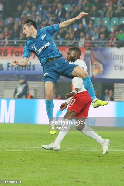 Vyacheslav Karavaev of Zenit St Petersburg and Ademola Lookman of RB Leipzig battle for the ball during the UEFA Champions League group G match...