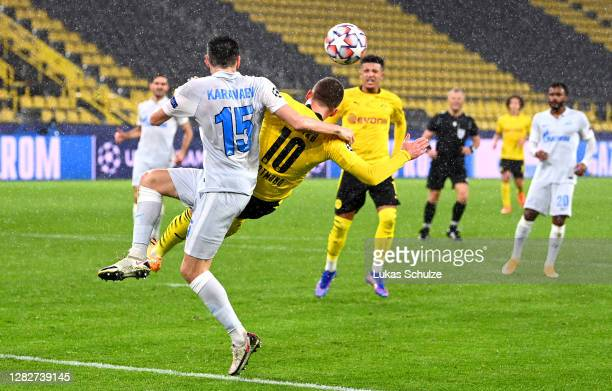 Vyacheslav Karavaev of Zenit St. Petersburg fouls Thorgan Hazard of Borussia Dortmund to concede a penalty during the UEFA Champions League Group F...