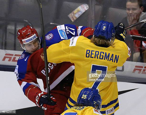 TORONTO ON JANUARY 4 Vyacheslav Leshenko and Julius Bergman collide as Team Russia plays Team Sweden in the semi final round of the IIHF World Junior...