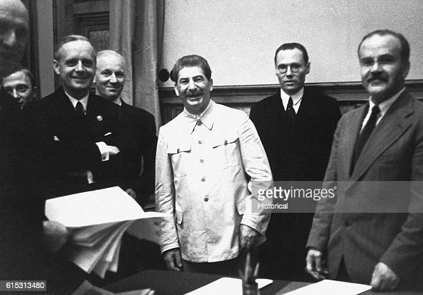Vyacheslav Molotov foreign minister for the USSR and Joachim von Ribbentrop foreign minister for Germany at the signing of the SovietGerman...