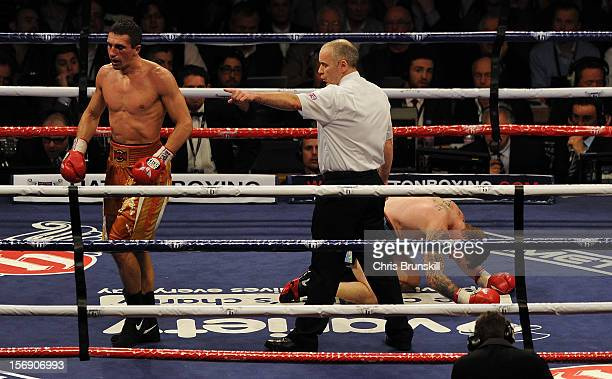 Vyacheslav Senchenko of Ukraine is sent to the corner by the referee after knocking down Ricky Hatton of Great Britain during their welterweight bout...