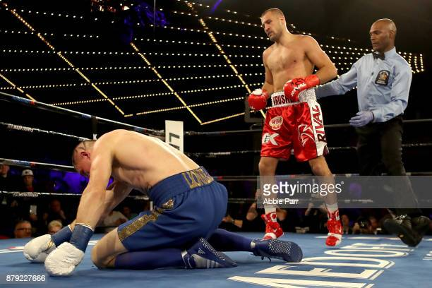 Vyacheslav Shabranskyyis knocked down by Sergey Kovalev during their Light Heavyweight at The Theater at Madison Square Garden on November 25 2017 in...