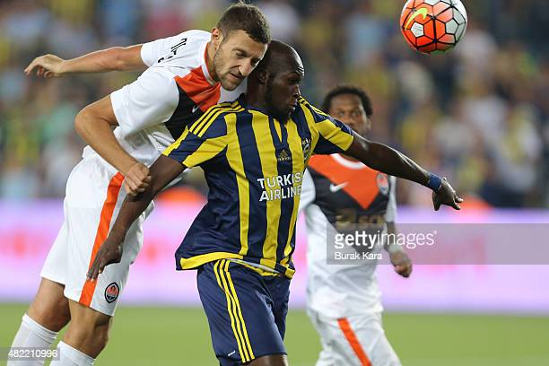 Vyacheslav Shevchu of Shaktar Donetsk is in action with Moussa Sow of Fenerbahce during UEFA Champions League Third Qualifying Round 1st Leg match...