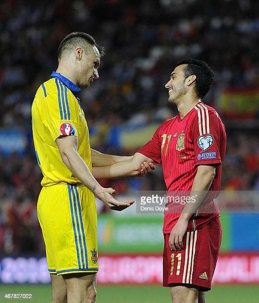 Vyacheslav Shevchuk of Ukraine has a word with Pedro Rodriguez of Spain during the Spain v Ukraine EURO 2016 Qualifier at Estadio Ramon Sanchez...