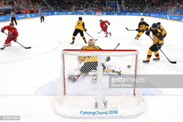 Vyacheslav Voinov of Olympic Athlete from Russia shoots and scores a goal in the first period against Danny Aus Den Birken of Germany during the...